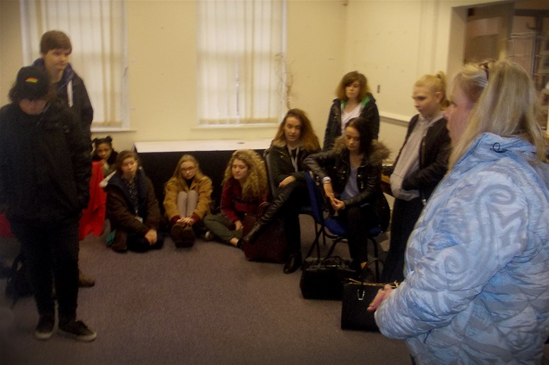 Julie Hamer of Incubation Arts (right) informs the students about her plans for Charles Roe House.