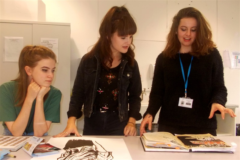 Students Sam Bunting (left) and Kate Darlington (right) presenting their current design projects to Sophie.