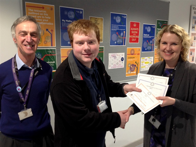 Jamie Cooper (centre) receives his certificates from Claire Ashworth, Programme Leader & Lecturer in Mathematics (right) with Maths Lecturer David Mayers (left).