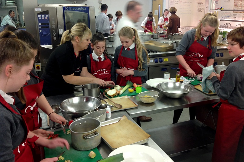 Pupils from All Hallows Catholic College in the Silk Room Restaurant's kitchen