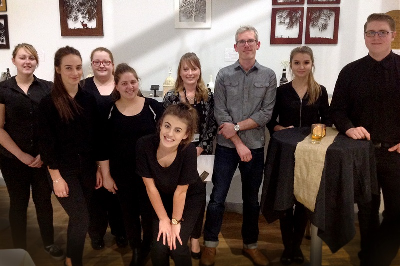 Students from the Hospitality and Event Management course with their lecturer Katie Aldous (centre, left) and local artist Stewart Morton (centre, right) from For Me & For You Designs