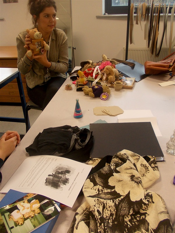 Leah Brookes with personal objects to help inspire her design concepts.