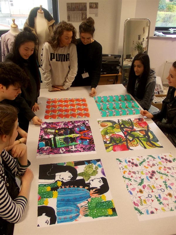 Students critiquing the samples of their print designs on Nylon Lycra back in the College's studio.